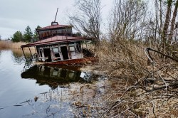 Chernobyl riverport photo now boat sunk abandoned